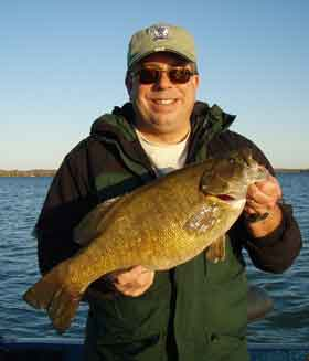 cameraguy boats a huge Mullett Lake smallmouth bass on a tube bait October 9 2008