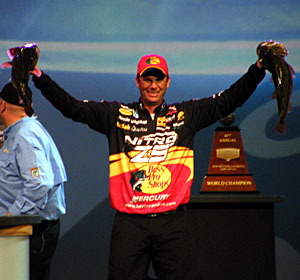 Kevin VanDam shows two big largemouth bass on stage from his 2011 Louisiana Delta Bassmaster Classic victory