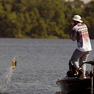 Region three winner Aaron Martens flips a bass into the air during a 2011 Bassmaster Elite Series tournament