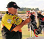 Mickey Thomas weighs in fish during the B.A.S.S. Southern Open on Alabama's Wheeler Lake.