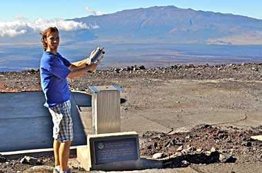 Aidan Colton at NOAA's Mauna Loa Observatory takes air flask samples to be analyzed for the industrial solvent methyl chloroform