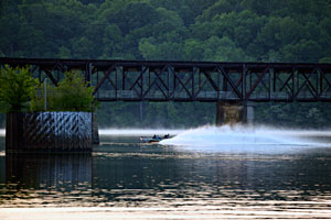 An Elite Series angler running under a bridge on Pickwick Lake practicing for the 2011 Alabama Charge