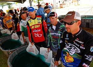 2011 Bassmaster Elite Series weigh in tent with tournament anglers waiting in line with their bass