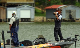 Bassmaster Elite angler Kevin Wirth sets the hook on a nice bass