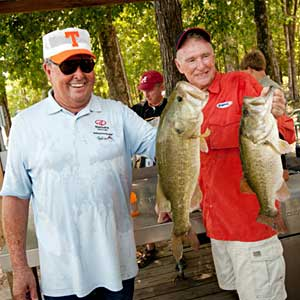 Bill Dance and Jerry McKinnis show off a couple of their big bass caught during the All-Star Week Legends tournament