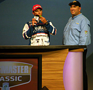Federation Nation national champion Brandon Palaniuk pays tribute to Bryan Kerchal by blowing his bass whistle at the 2011 Bassmaster Classic