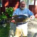 Bruce Kraemer with a new Michigan state record smallmouth bass he caught from the Indian River that weighed 9.98 pounds