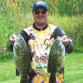 Don Watts with two of giant Indian River smallmouth bass caught during their Lake Drive championship victory
