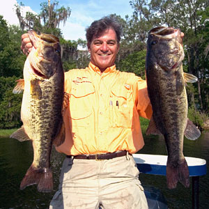 The Bass Professor Doug Hannon dies at home in Keystone Florida March 28 at 66 years of age, pictured here with two giant largemouth bass