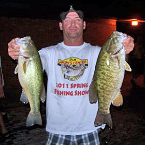 Doug Myers with two of the team's bass including the big smallmouth bass of the night from the final NBAA Division 17 Gull Lake bass tournament