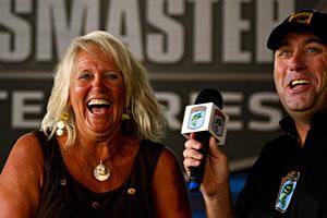 All-Star week fan finalist boat winner Cynthia Ryan of Farmerville Louisiana celebrates with B.A.S.S. emcee Dave Mercer