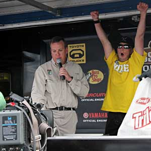 Unknown bass pro Fletcher Shryock celebrates taking the lead going into the final day of the B.A.S.S. Southern Open on Lake Norman
