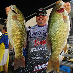 Phoenix Arizona bass pro John Murray shows off two big smallmouth bass from the 2008 Empire Chase Elite Series event