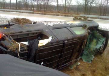 Kim Stricker's new Chevy Suburban lies on its side after a rollover accident on Interstate 70 near Effingham Illinois