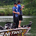 Detroit Lions Coach Jim Schwartz and Kevin VanDam fish Kent Lake during the 2013 KVD Charity Classic charity bass fishing tournament June 10th