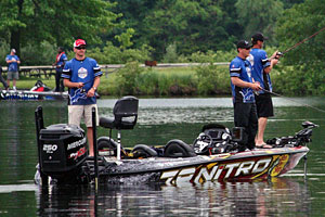 Detroit Lions Coach Jim Schwartz and Kevin VanDam fish Kent Lake along with one lucky sponsor drawing winner (back deck) during the 2013 KVD Charity Classic charity bass fishing tournament June 10th