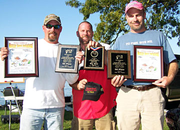 Kyle Green (L) and Scott Dobson (R) display all the top trophies from the dominating Monsterquest record limit and big bass award for the 6.78 pound toad