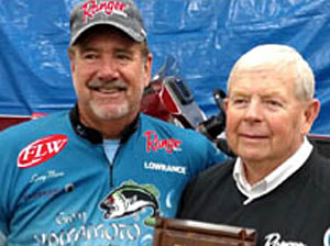 GreatLakesBass.com member Steve Clapper is inducted into the Freshwater Fishing Hall of Fame by friend Larry Nixon. Photo credit: Millenium Promotions
