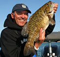 Louie's largest smallmouth to date is a 6-14 beast taken from Burt Lake in Northern Michigan caught on a Strike King tube in 3' of water in the fall of 2008