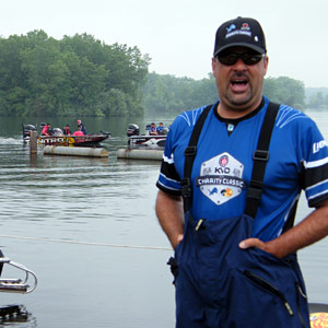 Mark Zona does a little all-in-good-fun trash-talking about ending up last boat out before the June 10th 2013 KVD Charity Classic tournament as KVD drives by in the background