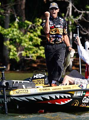 Professional angler Michael Iaconelli pumps his fist in the air after landing another nice bass during a 2011 Elite Series event