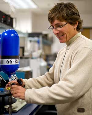 NOAA's Patricia Lang prepares to measure methane levels inside a flask as part of the global air sampling network