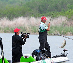 Diet Mountain Dew pro Jason Christie of Oklahoma catches one of his five bass early Saturday in his PAA All Star Series win on Lake Ray Hubbard