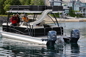 It's easy to park Premier's 27 foot Sunstation Walk-on pontoon boat thanks to the Yamaha Helm Master integrated digital controls.