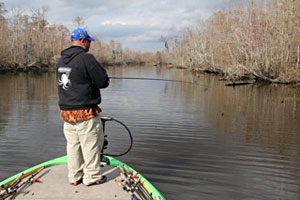 2011 Bassmaster Classic contender Bill Lowen fishes a wood-lined channel of the Louisiana Delta