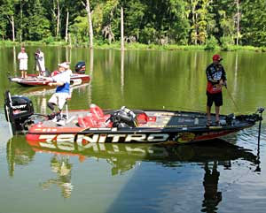 Bassmaster Kevin VanDam fishes with Sgt. 1st Class Jacque Keesler during the 2010 event