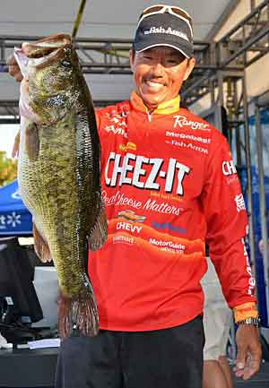 Shinichi Fukae holds up an 11-pound largemouth that anchored his 29-pound stringer
