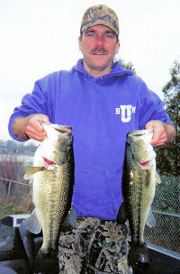 South Bend, IN angler Doug Roher poses with a 6# and 4# largemouth bass caught in early spring.