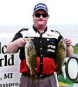 Dan Kimmel with 2 Houghton Lake smallmouth bass from 2005 Top Bass