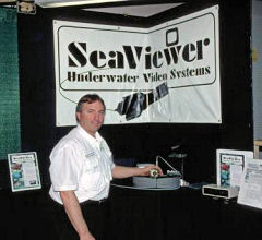 Wayne Carpenter demonstrates Seaviewer underwater cameras at his show booth