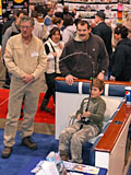 Outdoorama is a family-fun show. This youngster battles a big salmon on the Virtual Fishing Simulator.